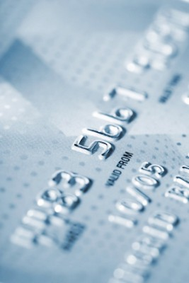 Detail of credit card as background in blue tone